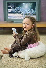 Feeling right at home on her living room carpet.