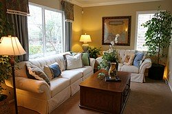 Wall to wall carpeting adds a warm feel to this living room.