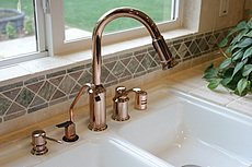 Copper faucet set up with all the extras.