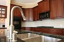 Satin Nickle gooseneck faucet with pullout sprayer.